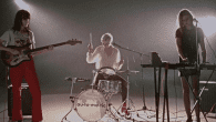 """Today, LA post-punk trio Automatic shares a new video. """"Too Much Money,"""" directed by SAMSONITE, is a lo-fi journey around Los Angeles through the eyes of a Bowie-inspired photographer.The video […]"""