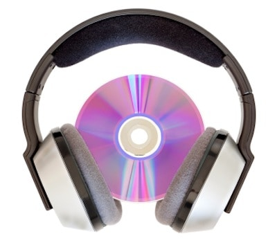 Wireless headphones and a CD for listening to music. On a white